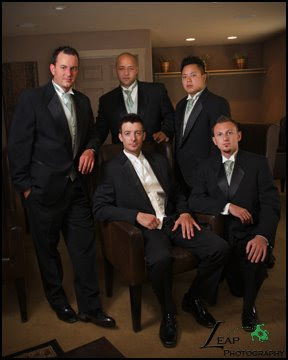a group portrait of the groomsmen