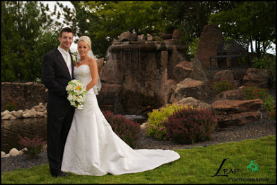 bride and groom by the waterfall