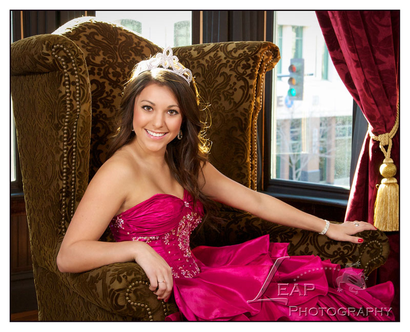 Quinceanera photo of girl sitting on chair