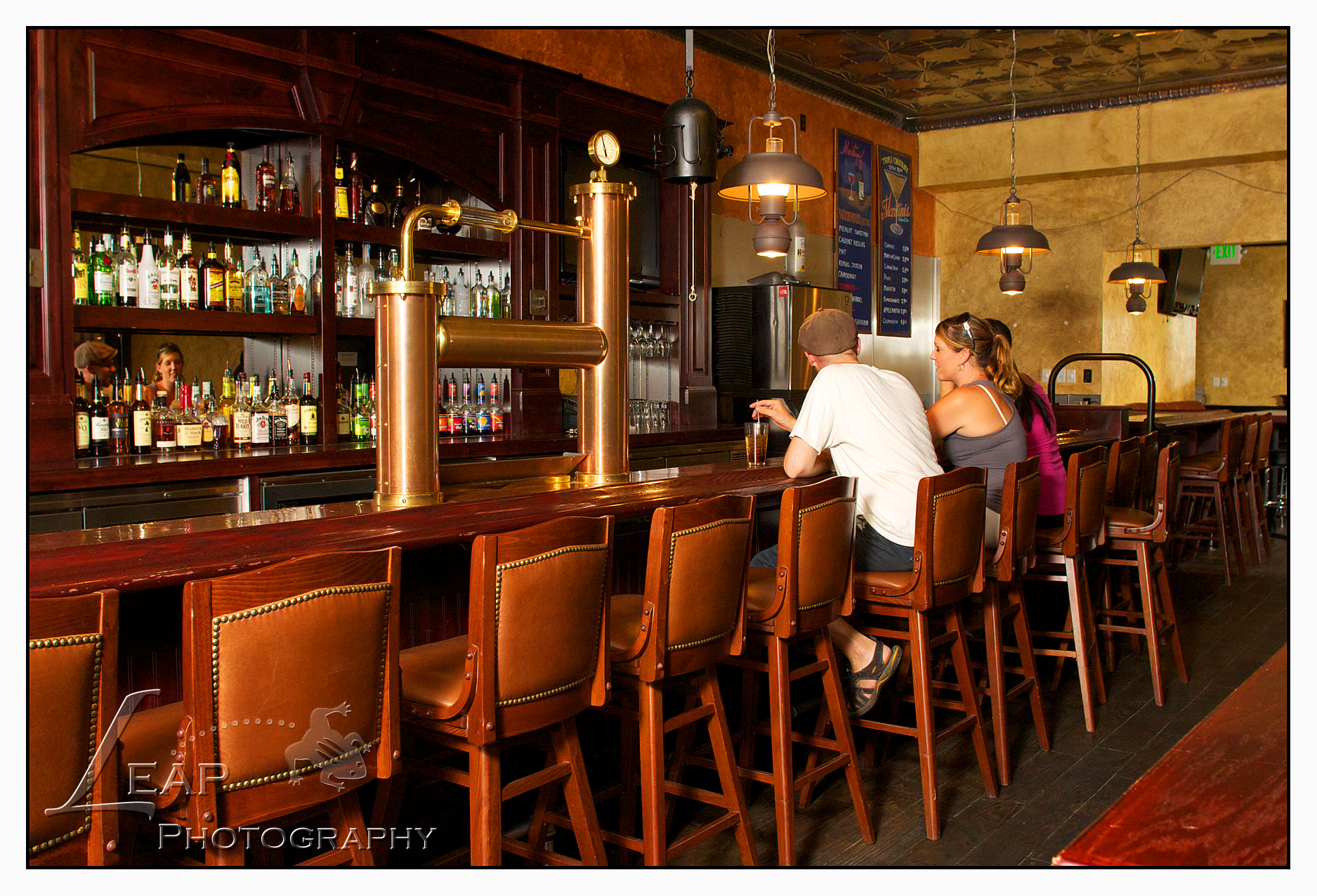 people sitting at bar on bar stools