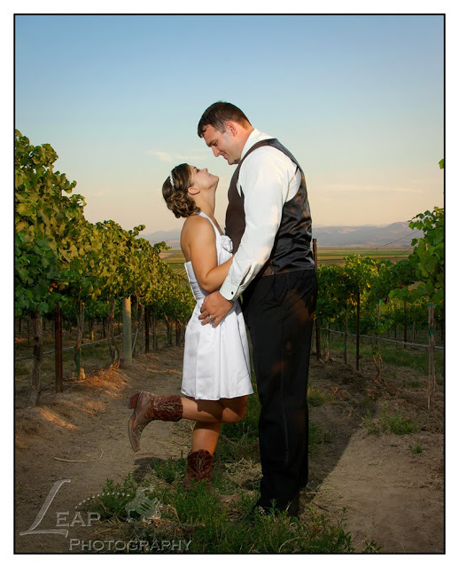 newly married couple standing in vineyard