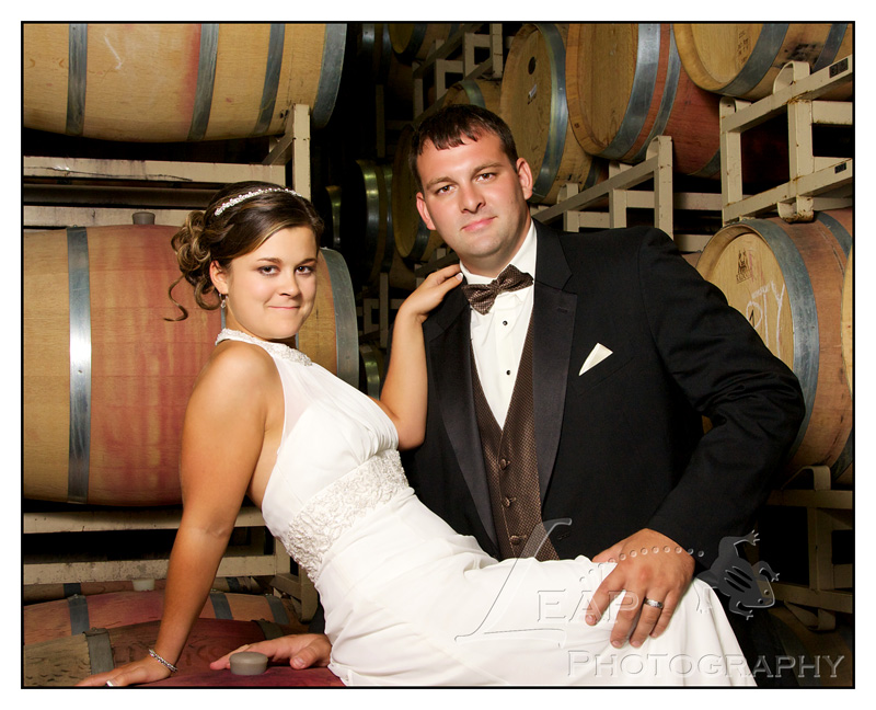 bride and groom photos in barrel room