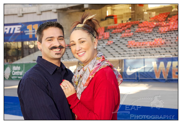 Engagement portrait on the BSU blue turf