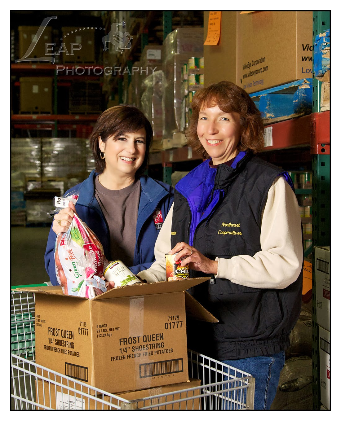 Terri Tate  & fellow employee, in the Idaho Food Bank warehouse