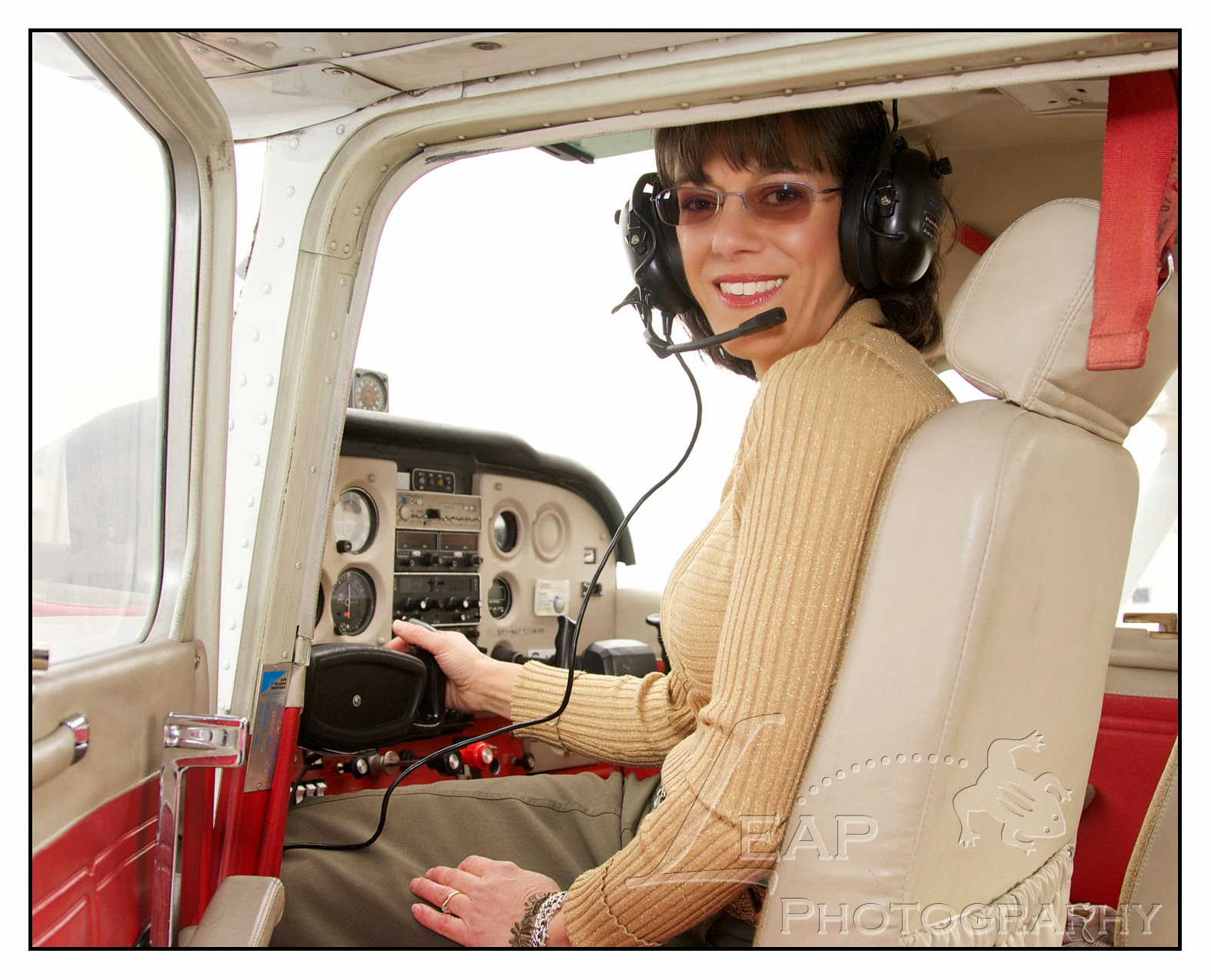 female pilot photographed in the cockpit