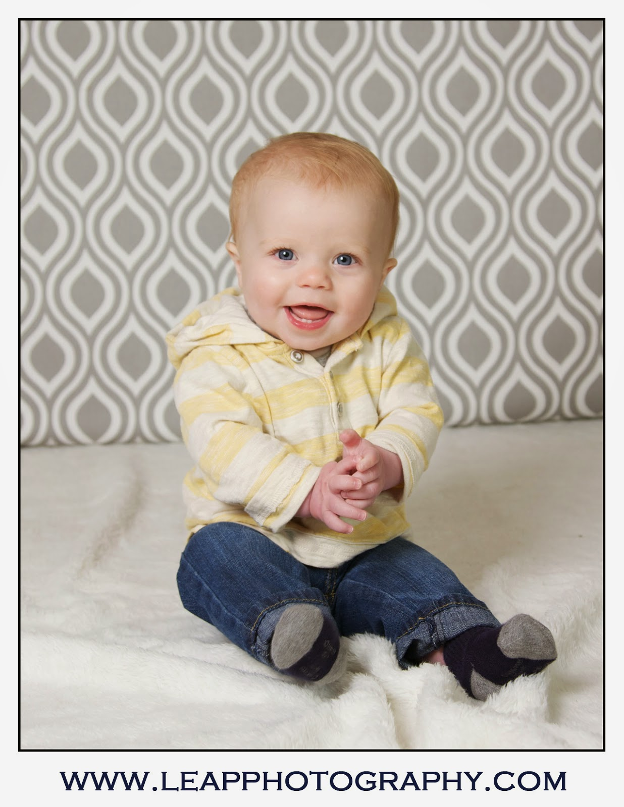 7 month old boy portrait with yellow stripped shirt
