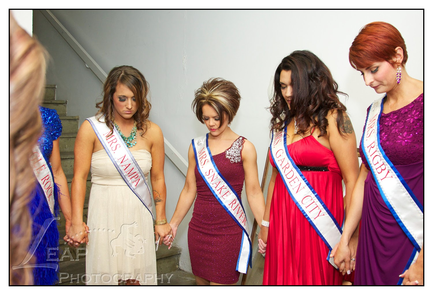 pageant ladies praying before the competition
