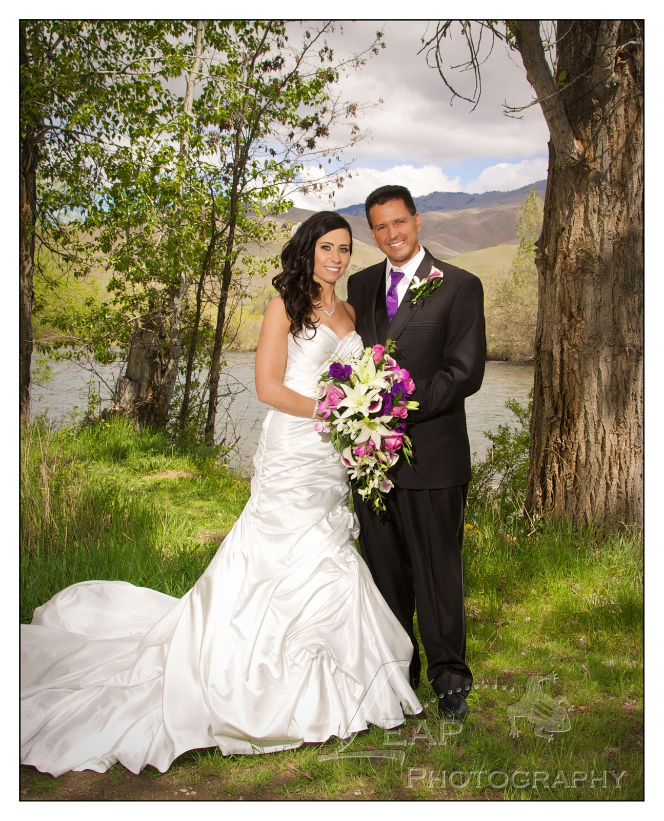 bride and groom on the Boise river banks