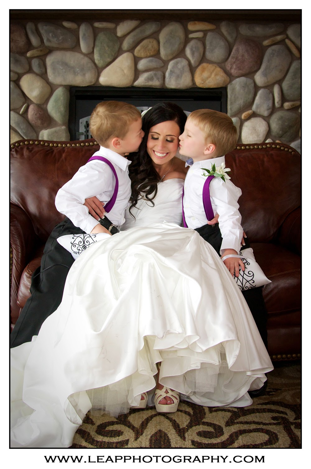 ring bearers kissing bride on the cheek