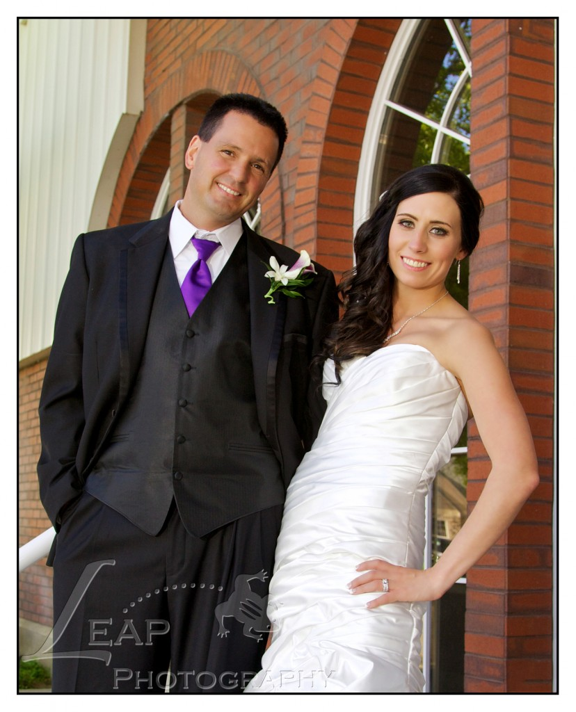 bride and groom on the steps of the clubhouse