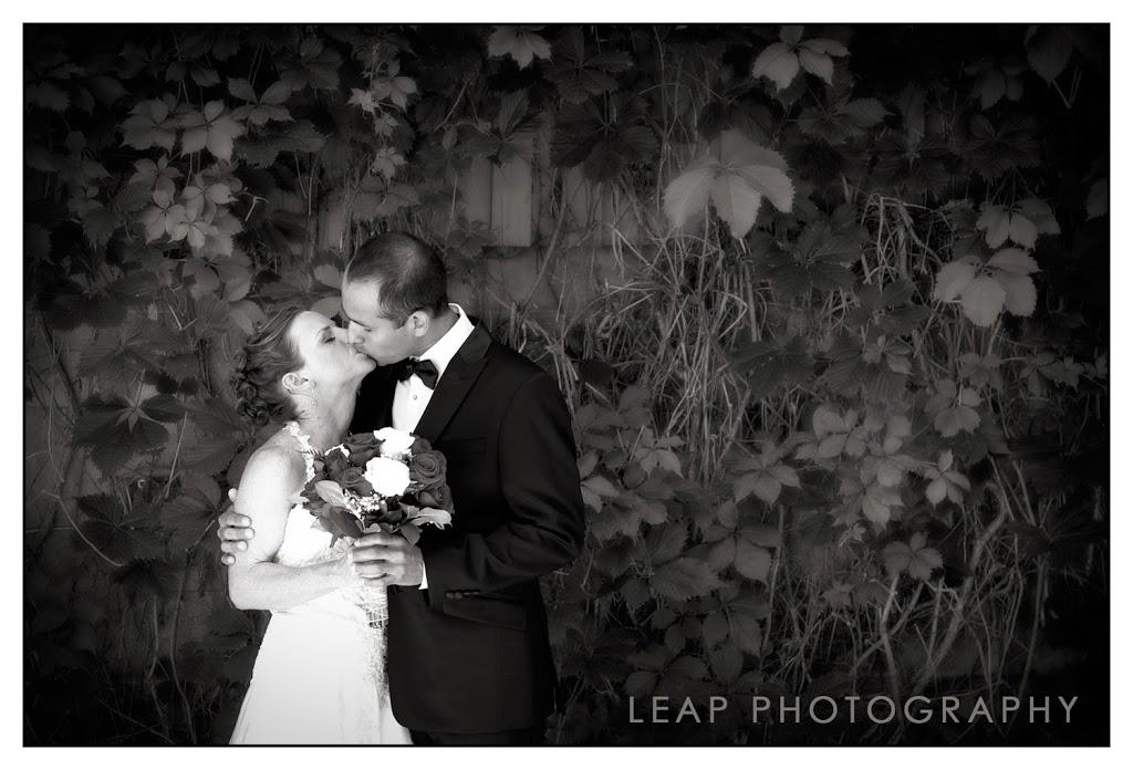 wedding portrait of couple kissing