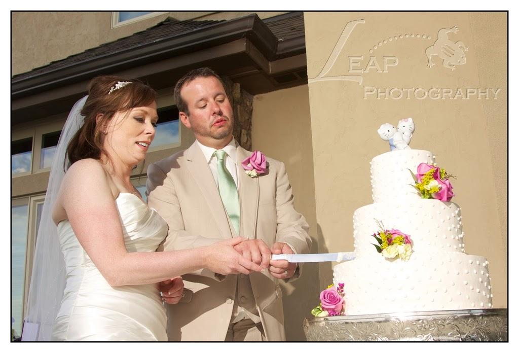 Boise couple cutting wedding cake