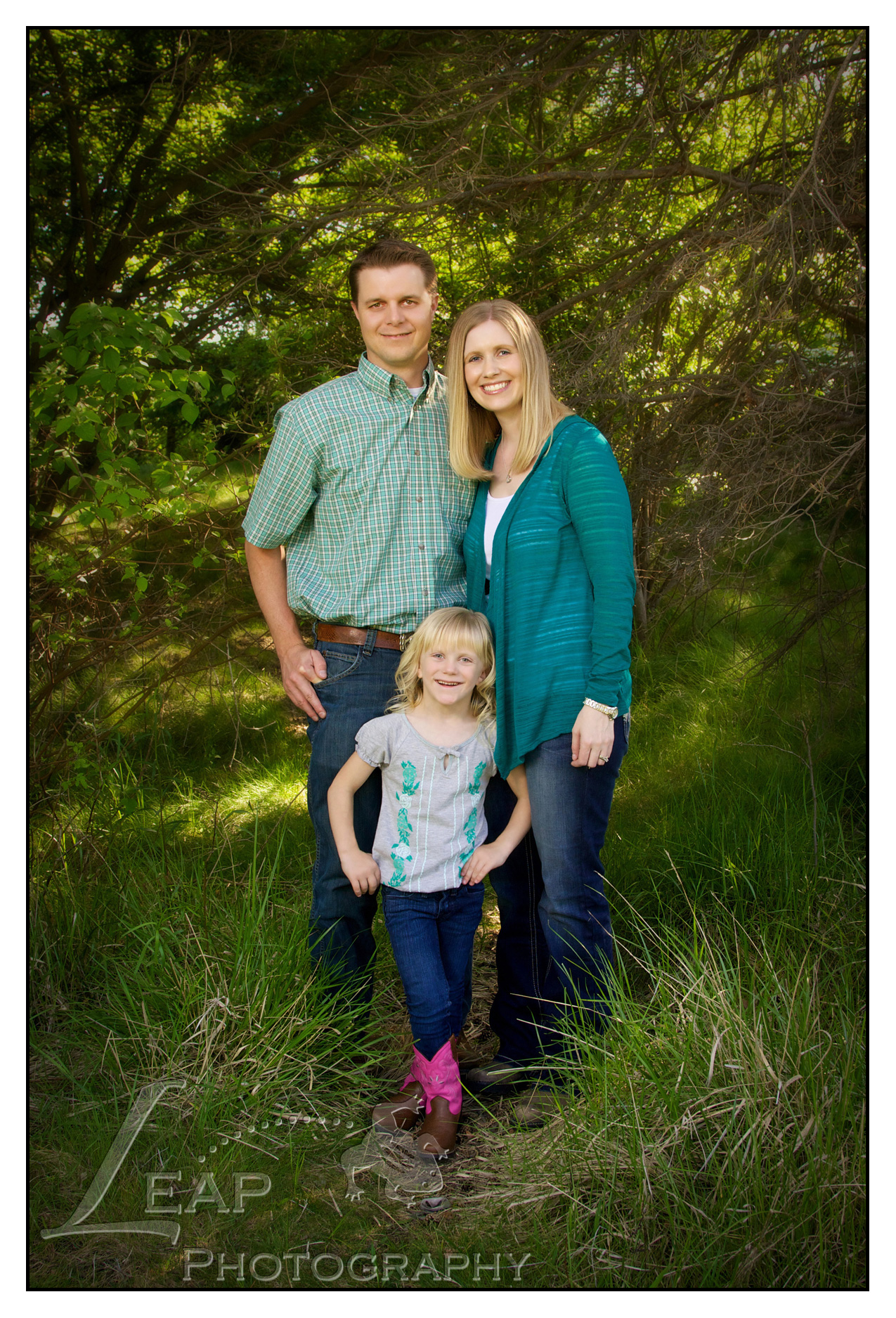 boise family standing in the tall grass.