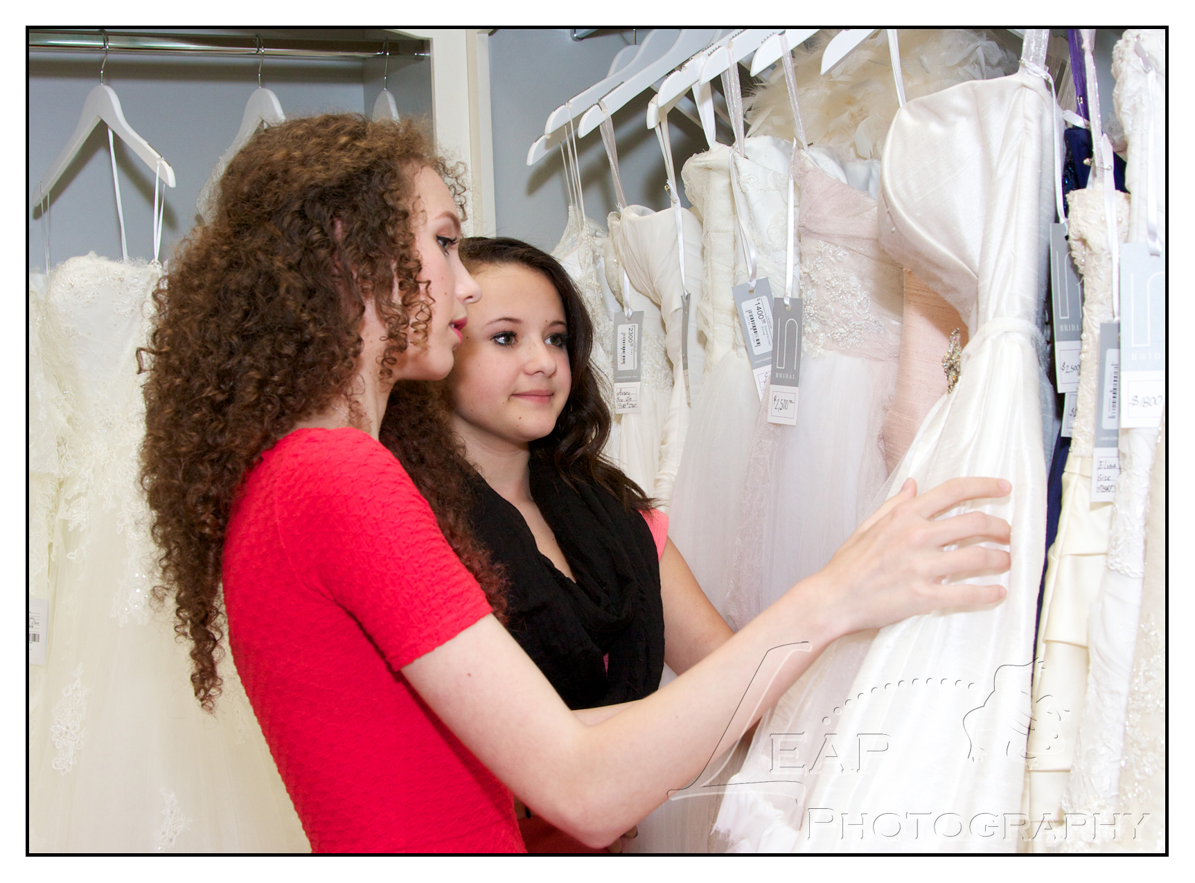 2 girls looking at bridal gowns