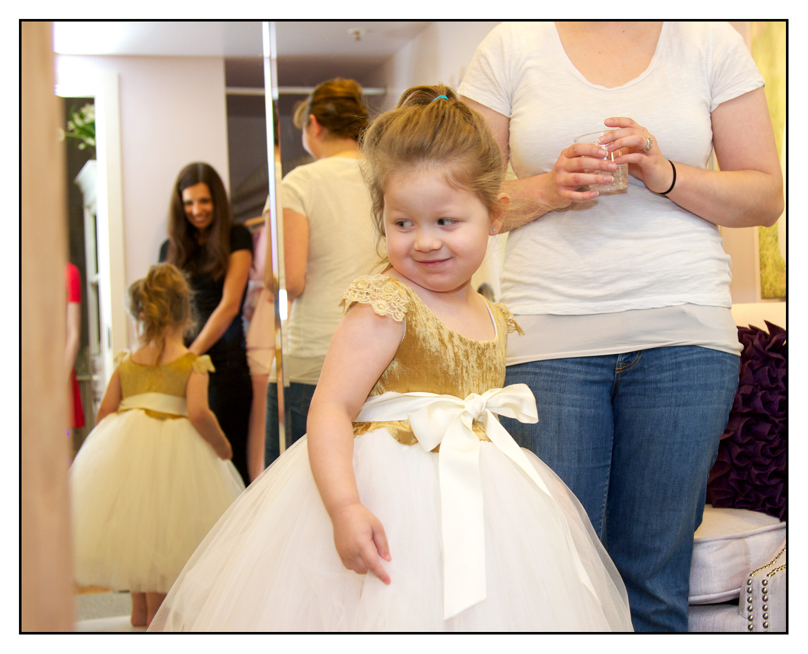 flower girl trying on dress
