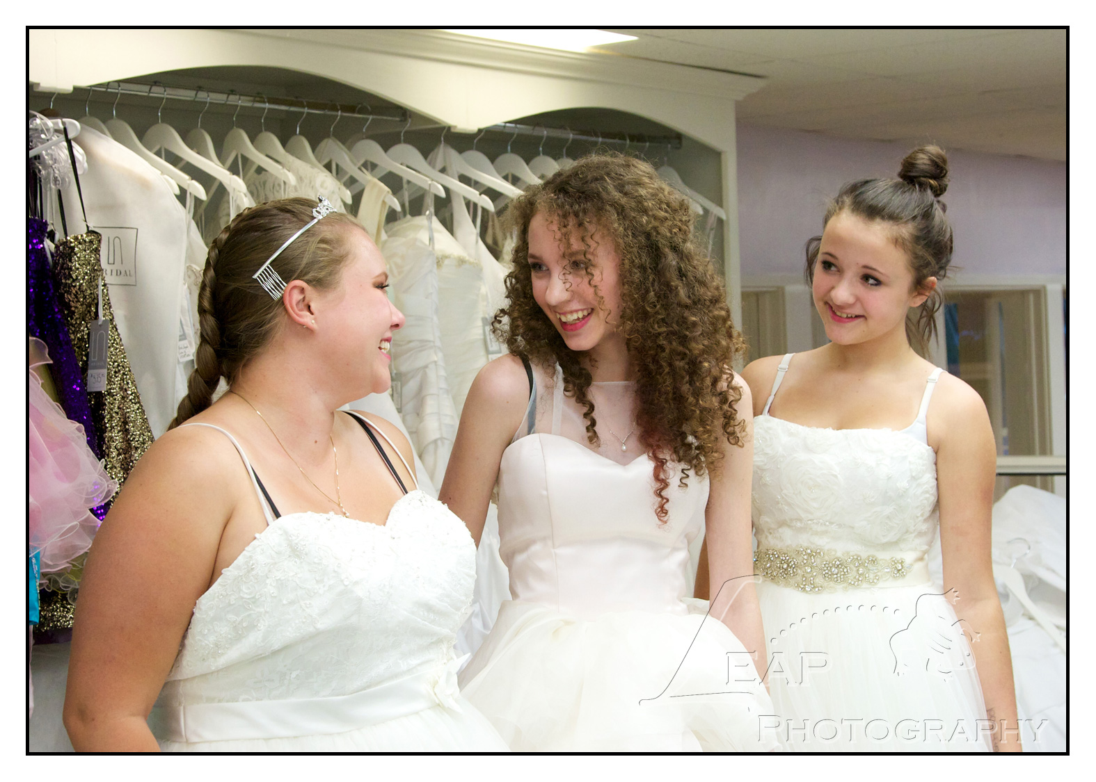 3 sisters in bridal gowns