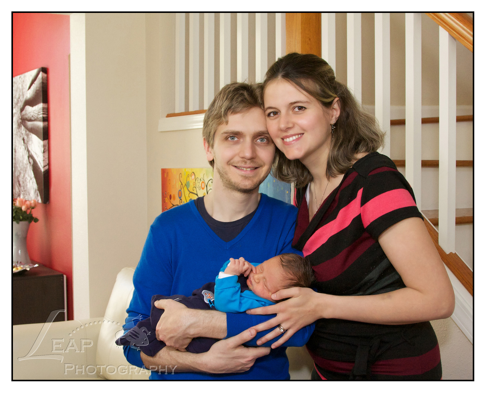 couple with their newborn child in their Boise home
