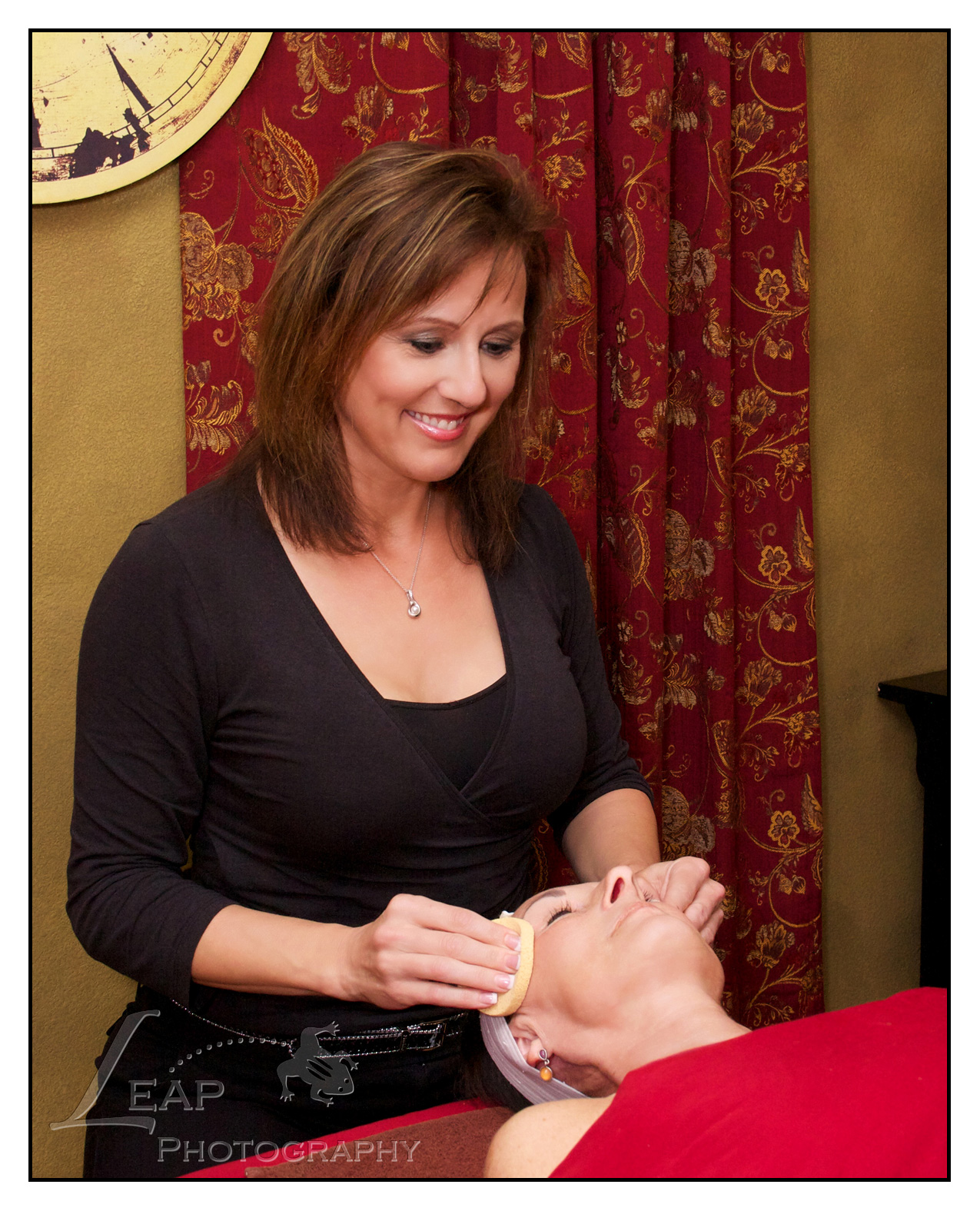 women giving a facial to another woman