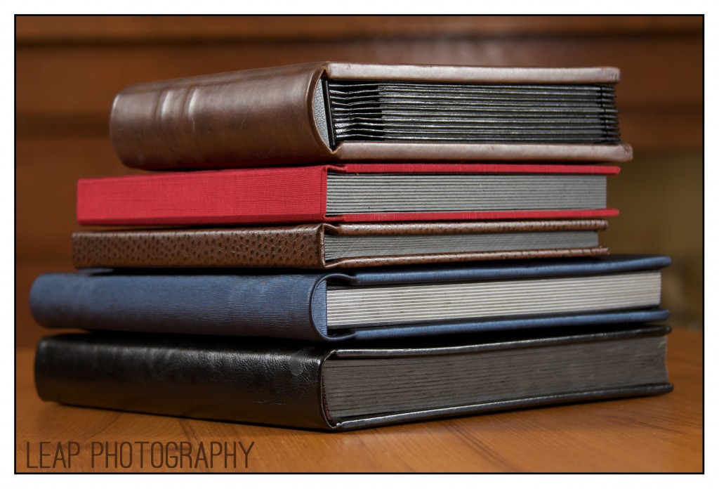 wedding albums in a stack