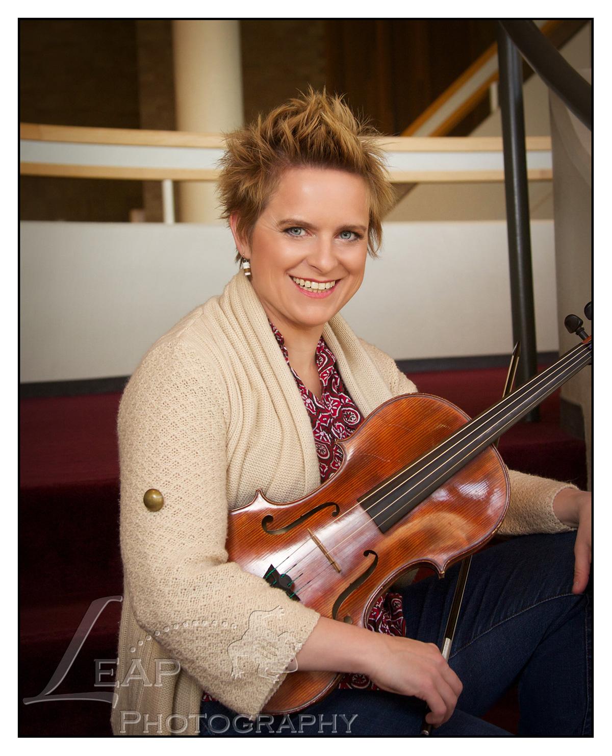 Boise Woman holding viola, in Morrison Center