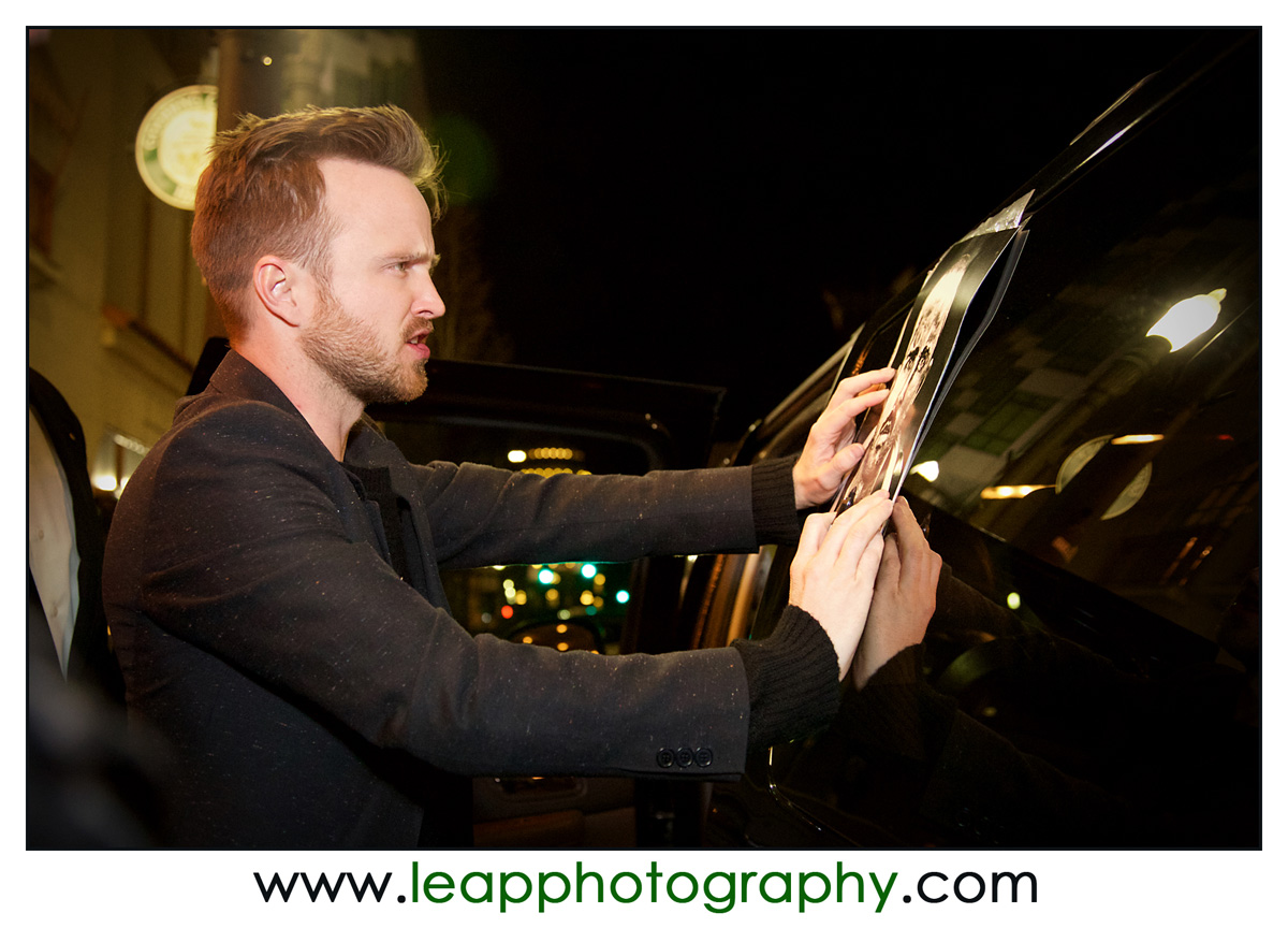 Aaron Paul signs his autograph