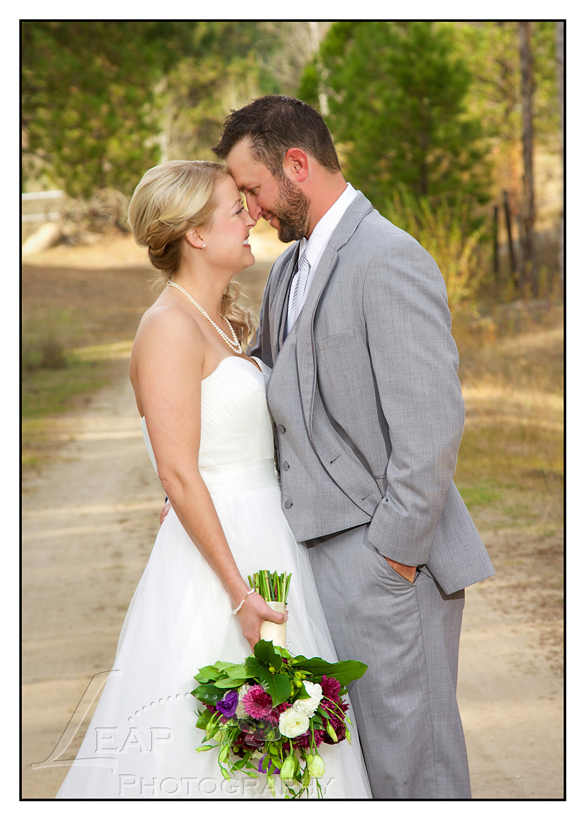wedding picture on dirt road