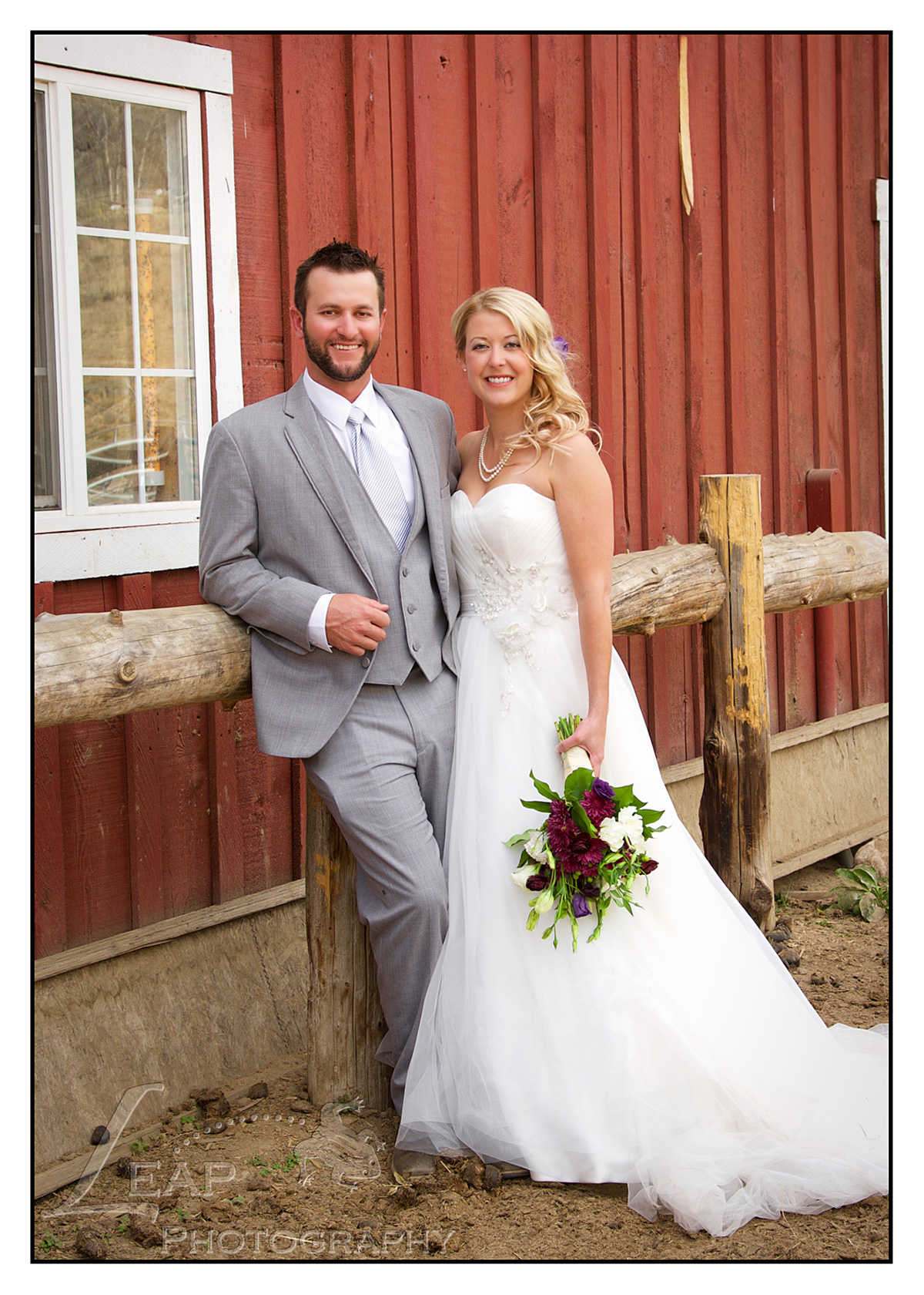 wedding portraits in front of red barn