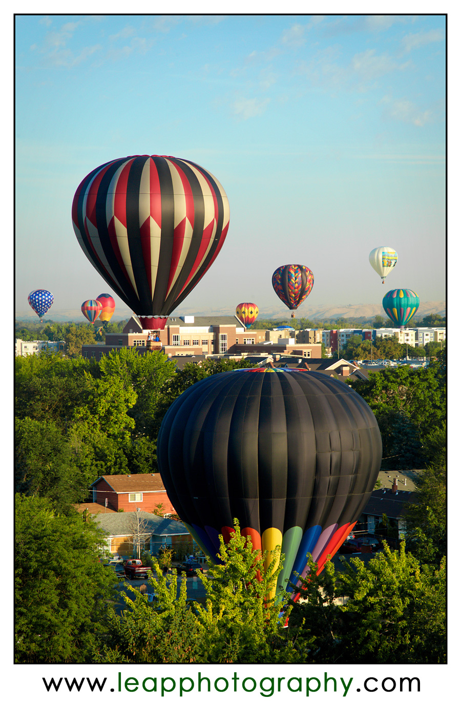 hot air balloons above downtown Boise