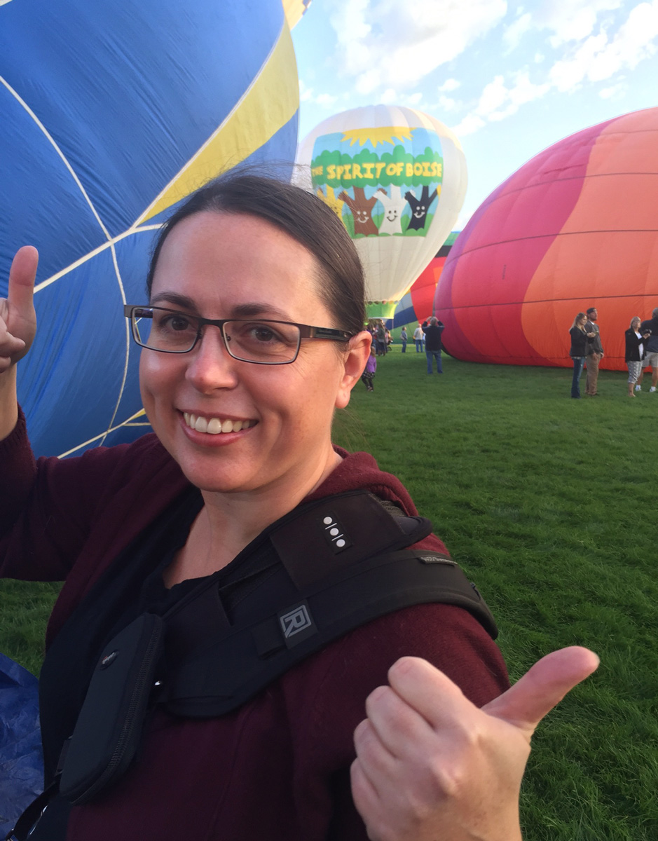 Brenda Leap standing in front of hot air balloons