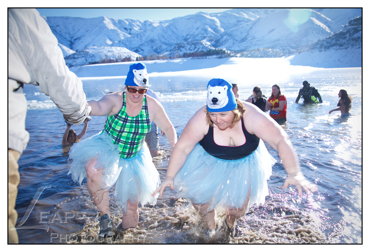 two women complete polar bear plunge
