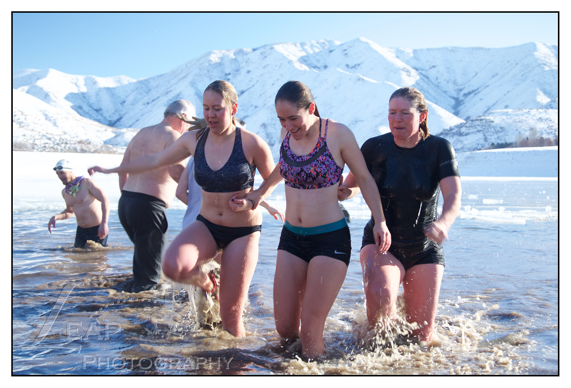 Women running in ice cold water