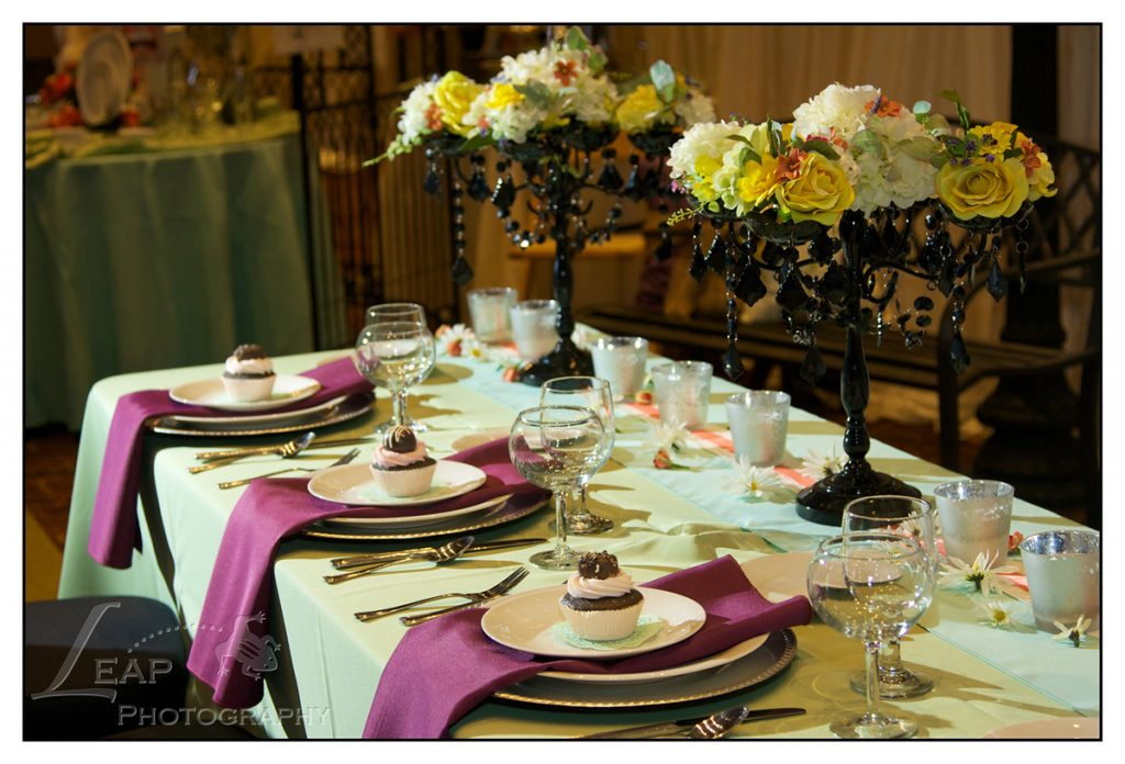 green and purple table decor at wedding