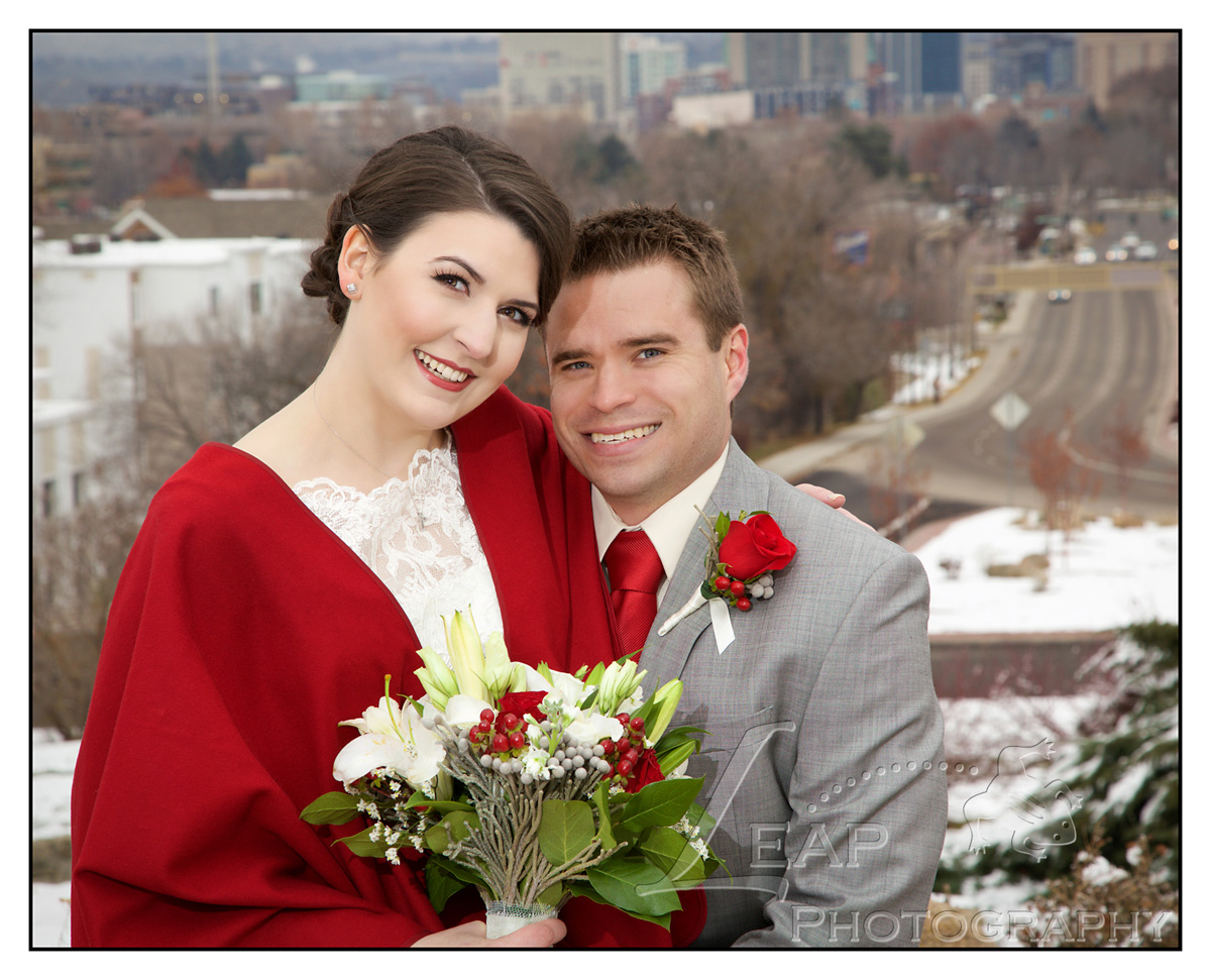 bride and groom with downtown Boise in background