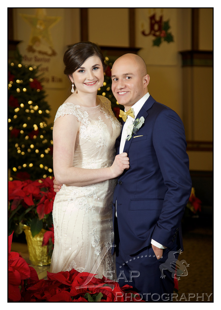 bridal portrait with Poinsettias and Christmas Tree