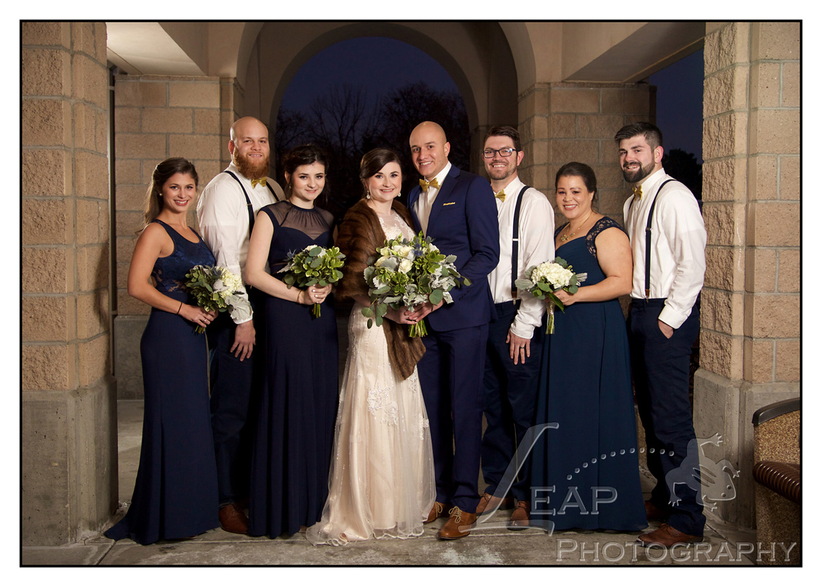 bridal party in navy and brown