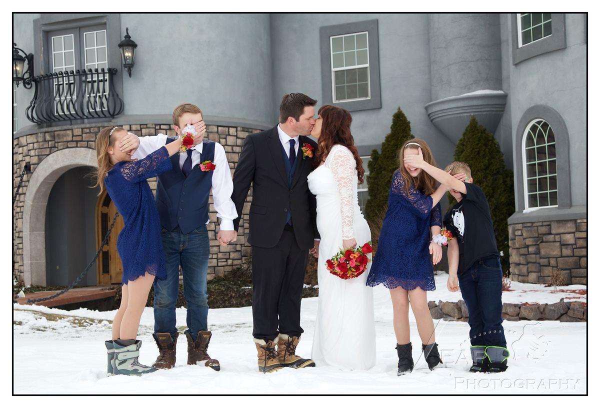 bridal party standing in the snow