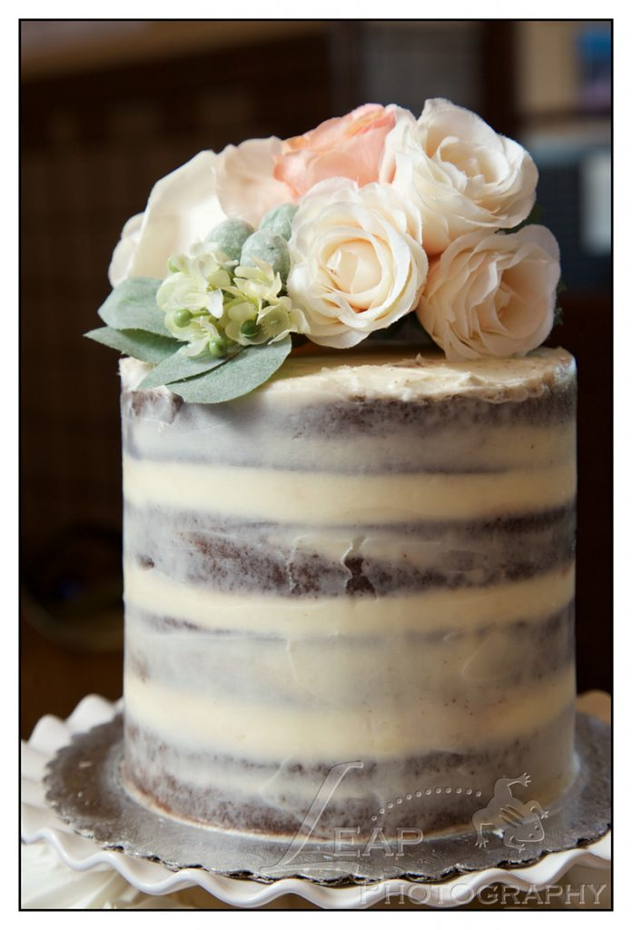 wedding cake with flower topper