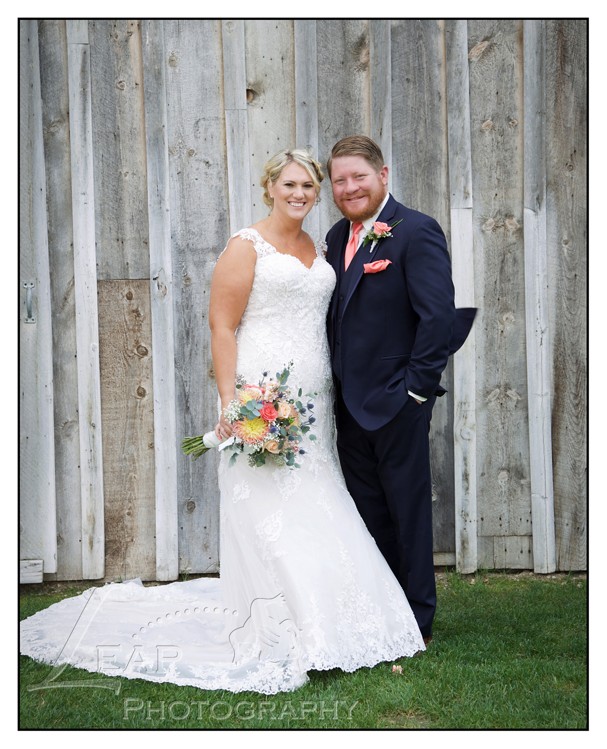 marriage portrait in front of barn