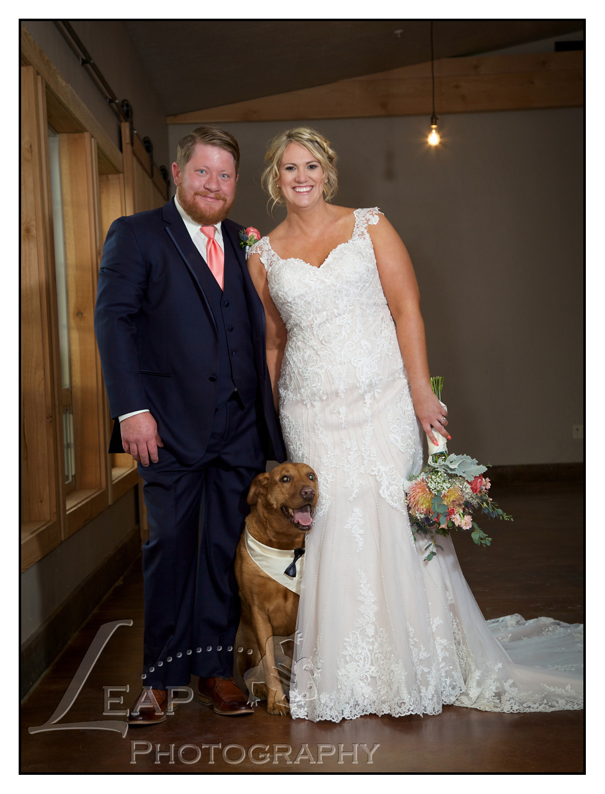 wedding portrait of couple with their dog