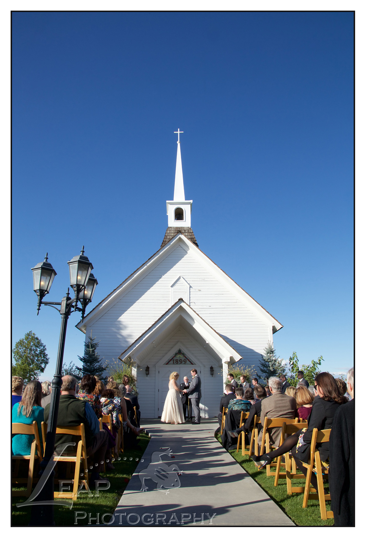 Wedding Ceremony in front of Still Water Hollow Chapel