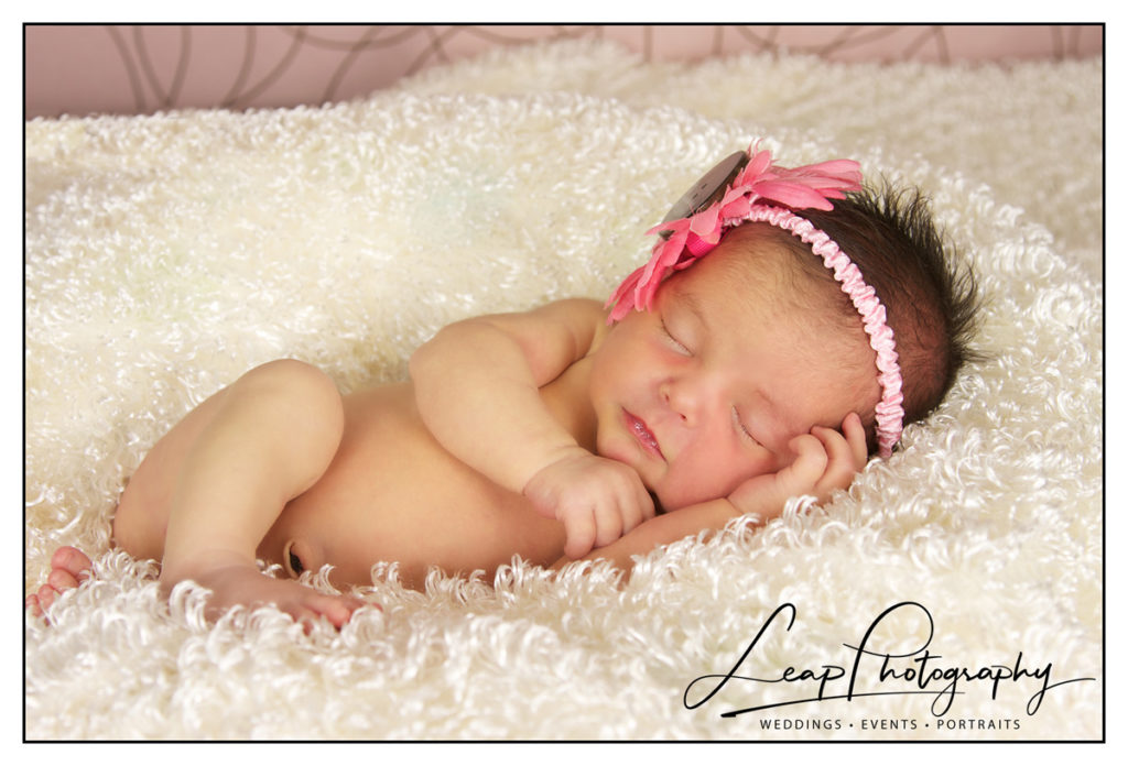 newborn girl in pink headband
