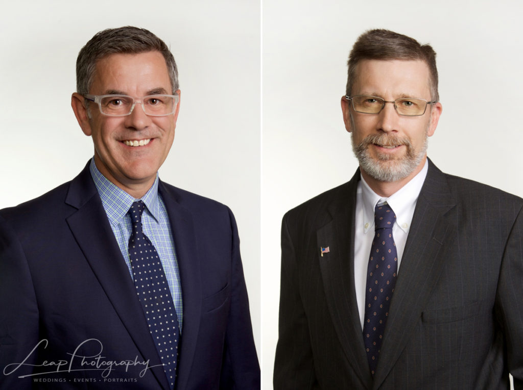 headshots of two different male professionals in suits