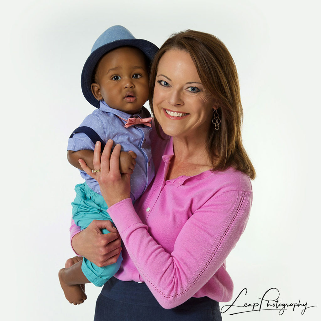 woman and baby on white background