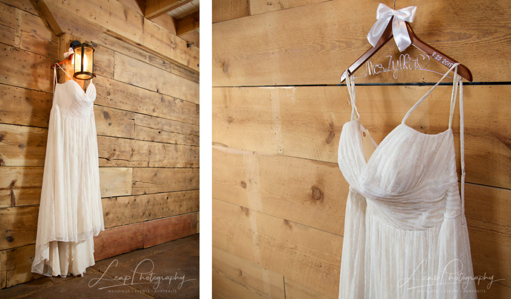 wedding gown hanging in barn