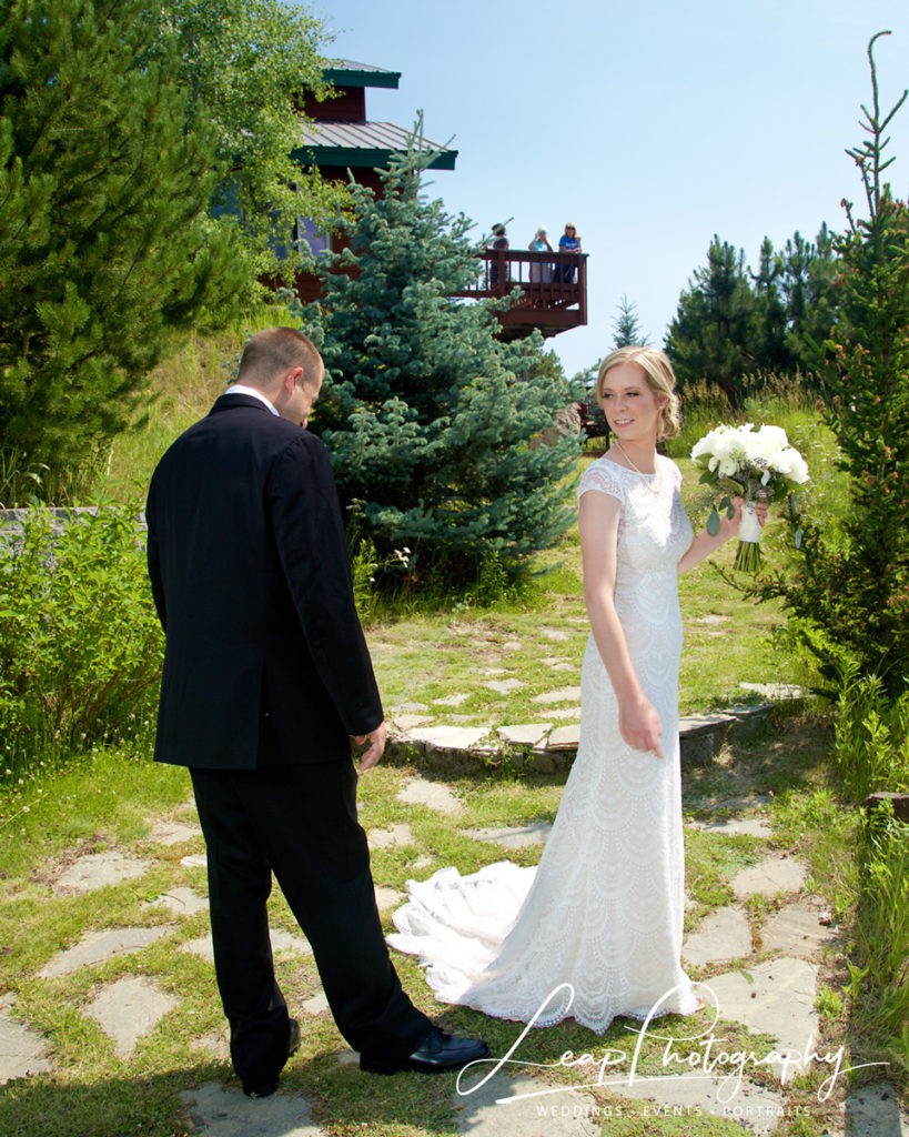 groom admires brides dress