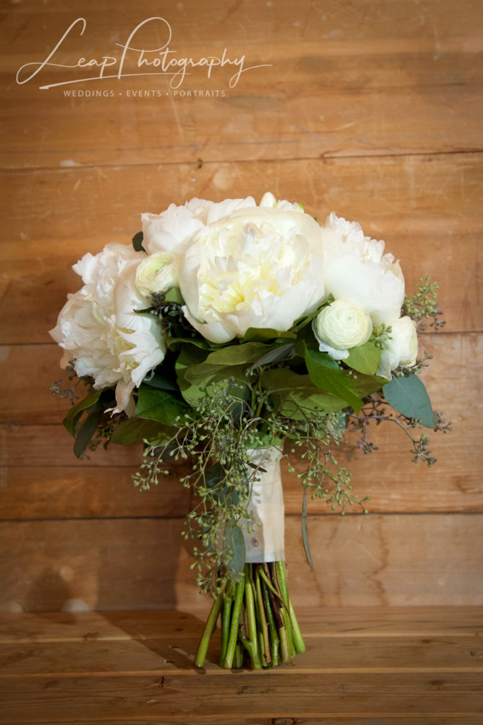 bridal bouquet with white roses and white peony