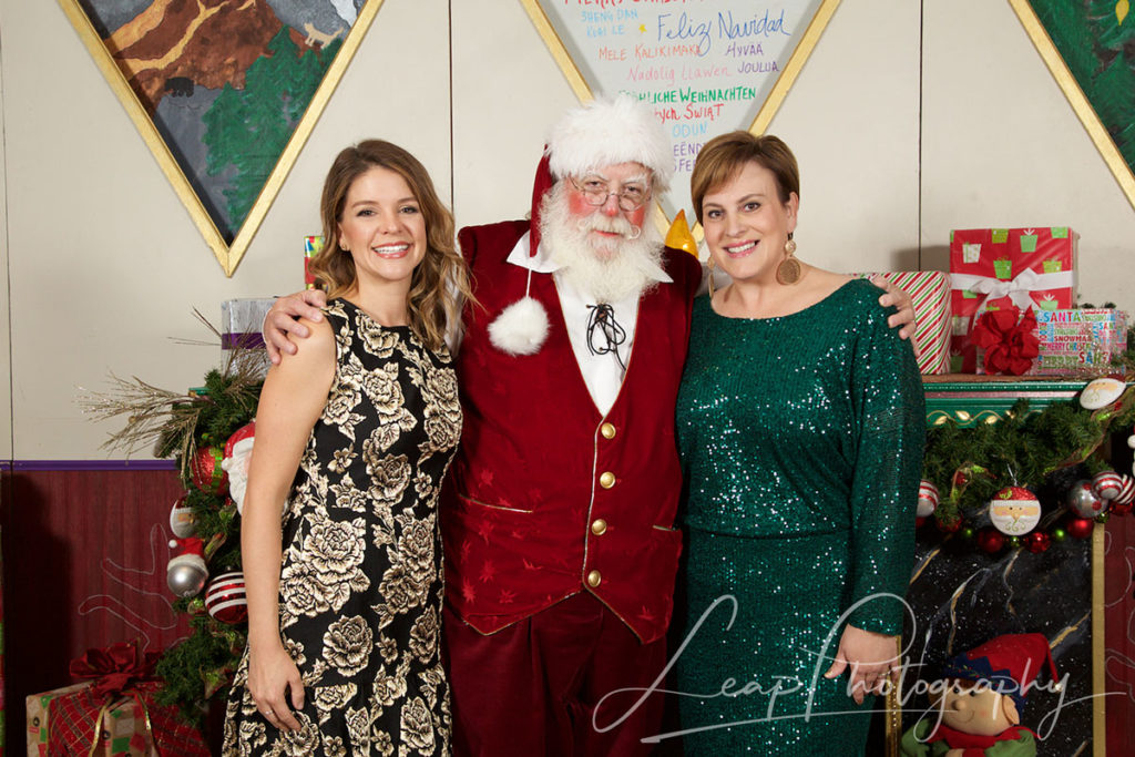 Santa with two women at boise event