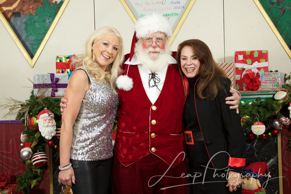 event photo of Santa with 2 women