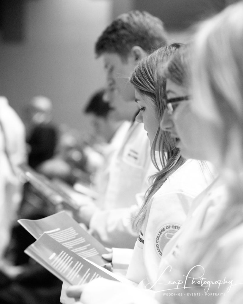 event photo of students during a white coat ceremony
