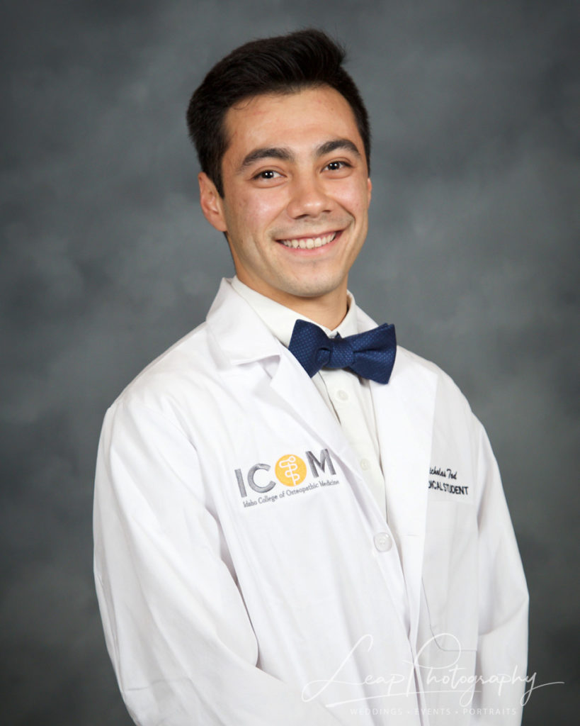 official white coat photo of male medical student